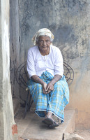 Woman on porch, Fort Kochi, Kerala, India