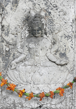 Hindu stone carving and flowers, Delhi, India
