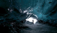 Climber at ice cave entrance, Iceland