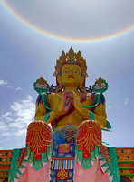 "Buddha statue and ""sundog"" (sun halo), Nubra valley, Ladakh, India"